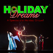A hologram of a reindeer with two holiday costumed characters