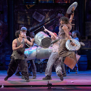 Stomp actor on stage jumping