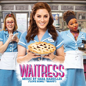 Three waitress the middle one holding a pie