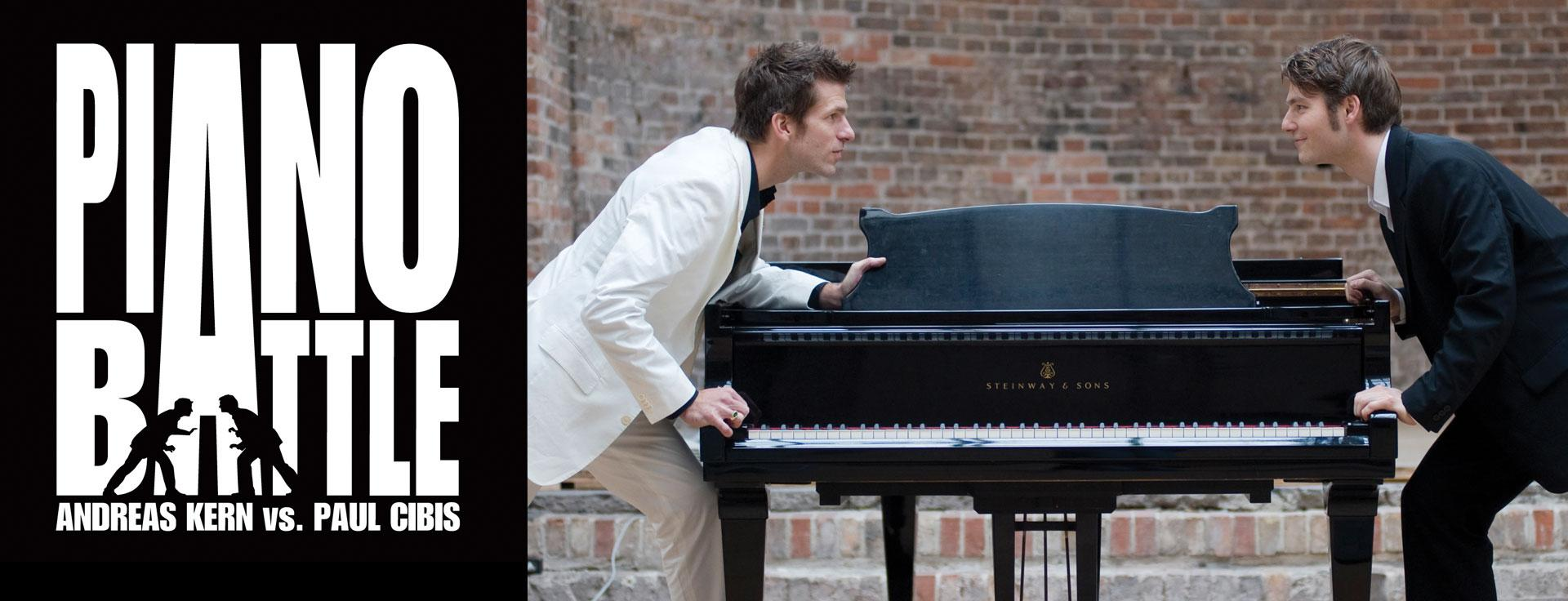 Two guys on either side of a piano grasping on the piano looking like they are ready for battle